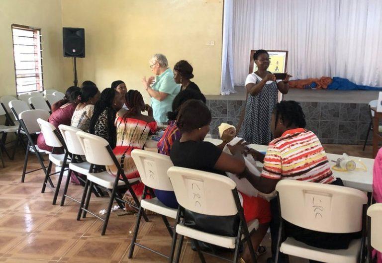 Neonatologist teaching newborn care in Seirra Leone