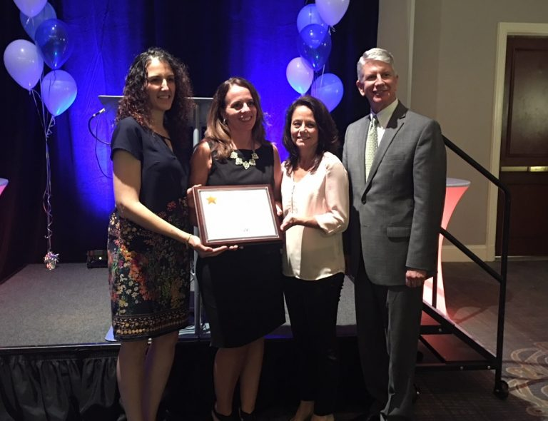 Onsite Neonatal Partners physician Dr Kimberly Costello receiving HAP Achievement Award with SLUHN Leadership